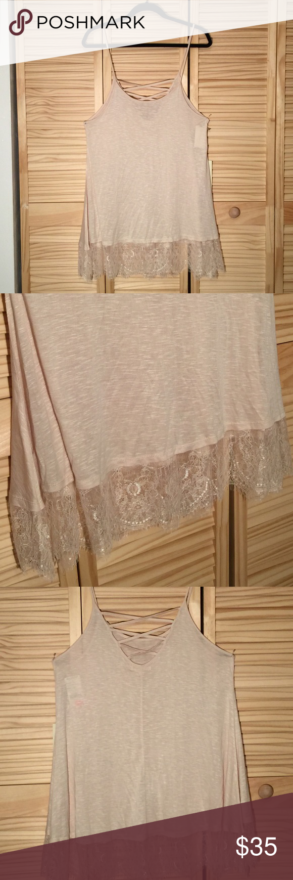 Ivory laced trim tank Never worn Ivory Lace trim tank top 26 inches in length 18 inches in width 100% rayon Isbel Tops Tank Tops