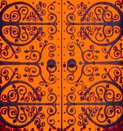 Beautiful Pattern Orange Door Iron Hinges Beautiful Doors