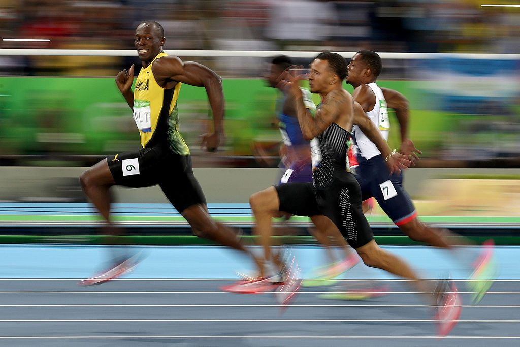 Winners are grinners! Usain Bolt of Jamaica competes in the Men's 100 meter semifinal. Photo Cameron Spencer/Getty Images