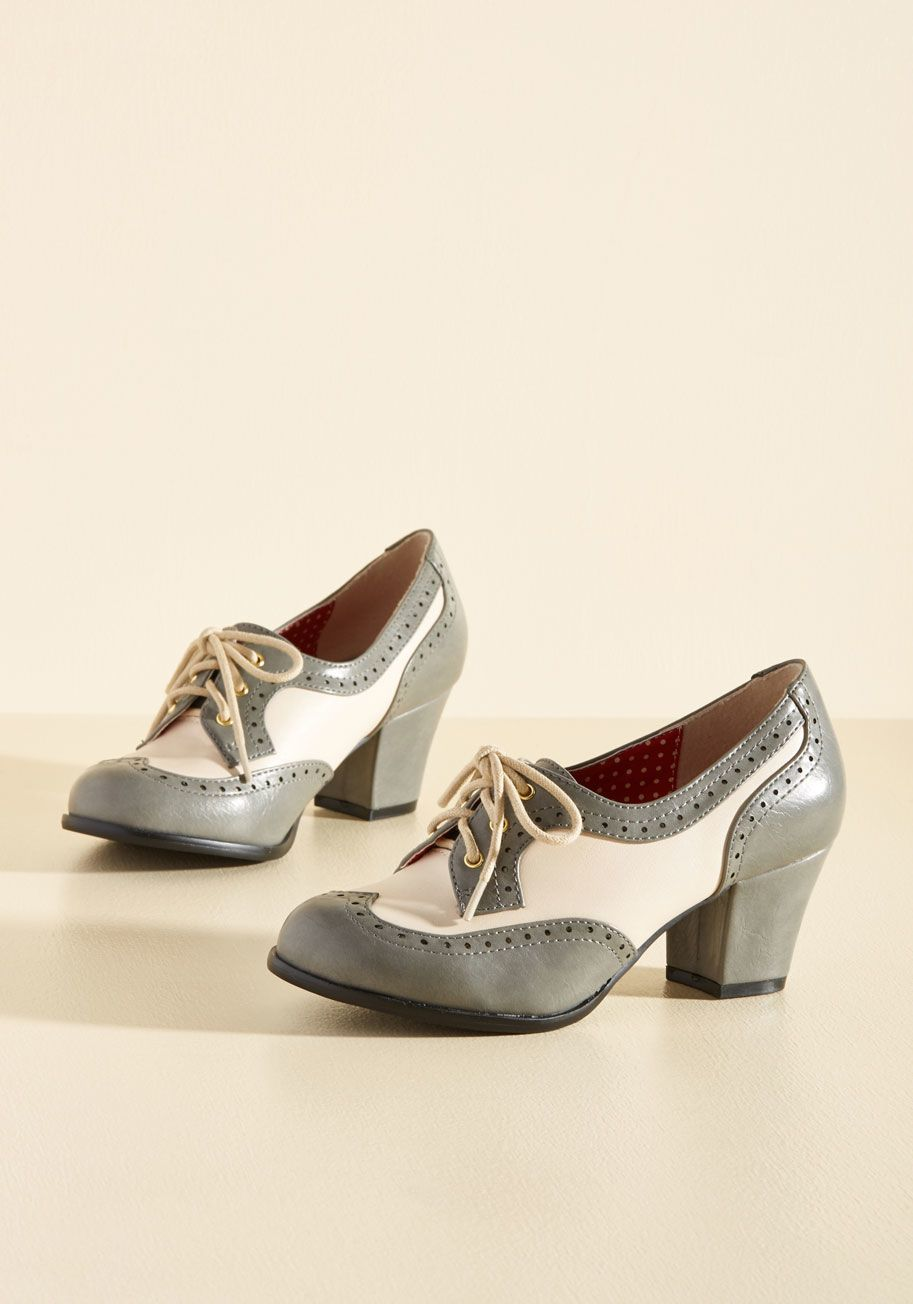 <p>Classic, charming, and endlessly cool - these brogues by B.A.I.T. Footwear earn themselves a grammatically refined list of compliments! These block-heeled beauties are constructed with pebble grey and cream faux leather and an array of eyelets that assert your scholarly composure with every step.</p>
