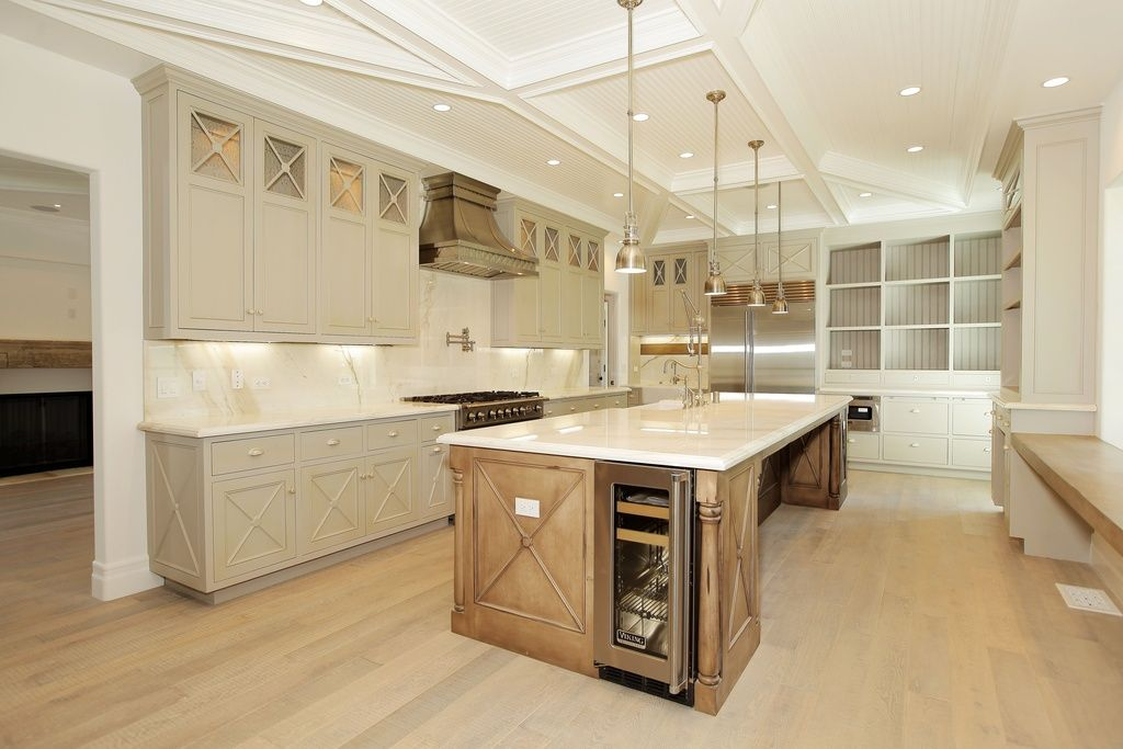 Traditional Kitchen with Wall Hood, wall oven, Complex marble