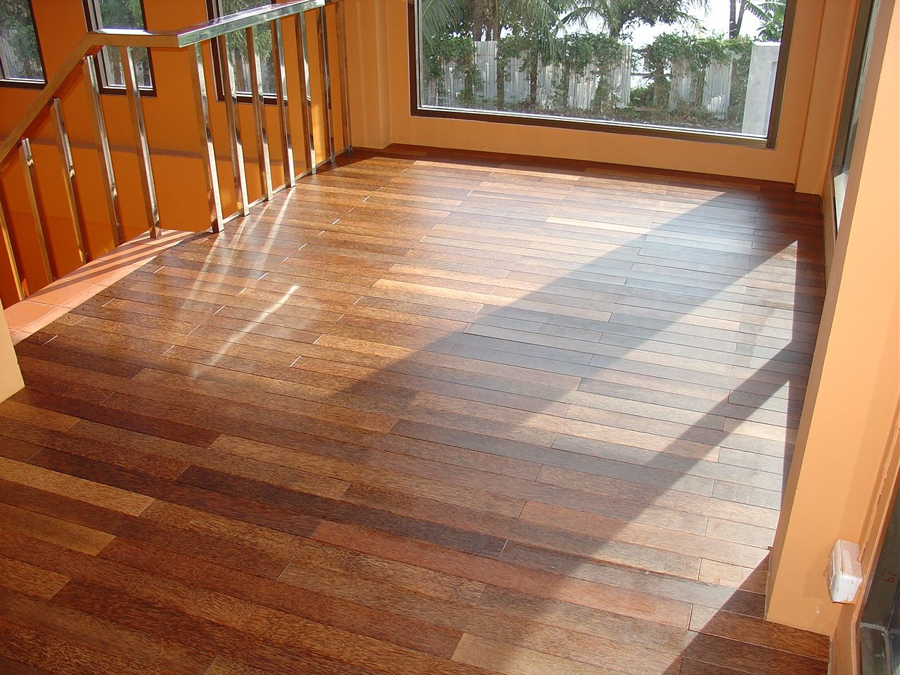 Drawing of Hardwood floor vs Laminate: The Pros and Cons ...