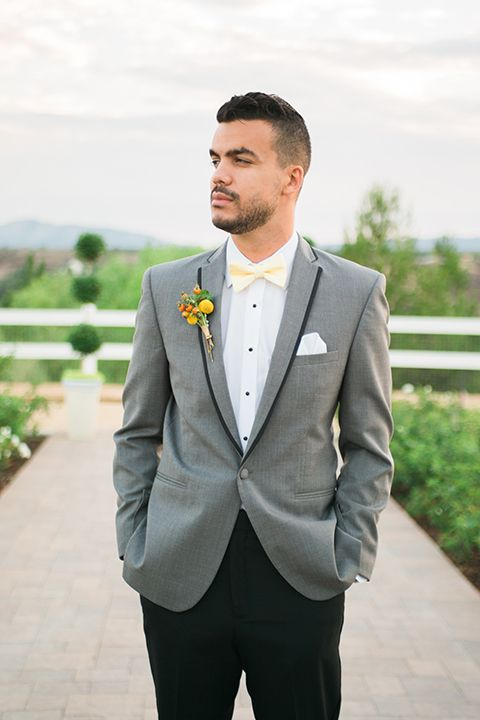 b52c9268 ... the hernandez estate groom grey coat with black trim on lapel and white  dress shirt with light yellow bow tie and black pants with white pocket  square ...