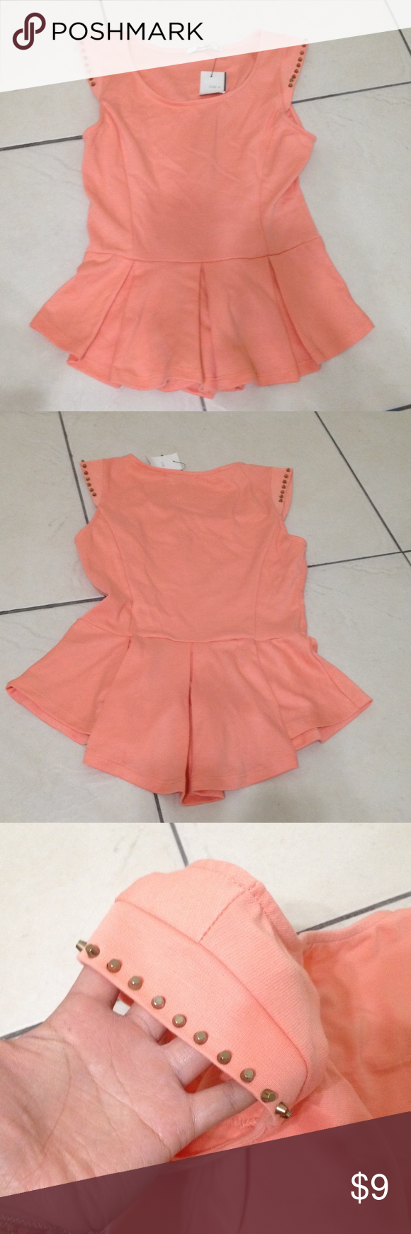 NWT Coral Peplum Top with Studded Sleeves Cap sleeves with gold studs along the edge. The bottom flares out in a semi-pleated peplum style. Stretchy polyester material. Papaya Tops Blouses