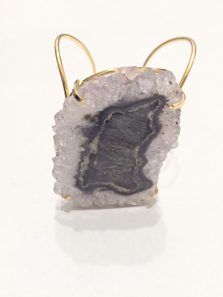This cuff is made from a beautiful amethyst stalactite stone. The stone is attached to a wire cuff. The wire...
