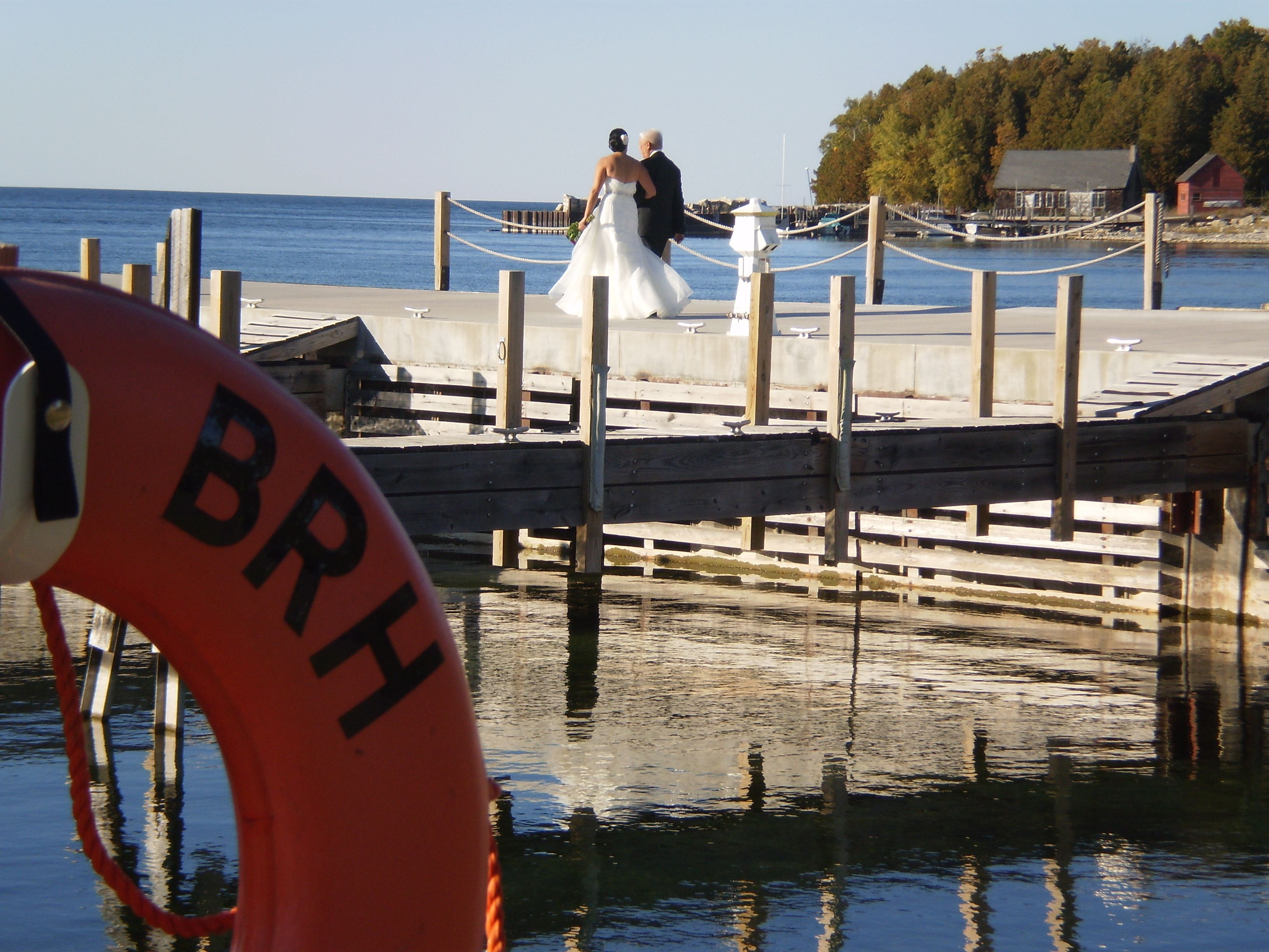 A stroll down the Bayview Resort & Harbor pier to get married! Congrats! September 2012.
