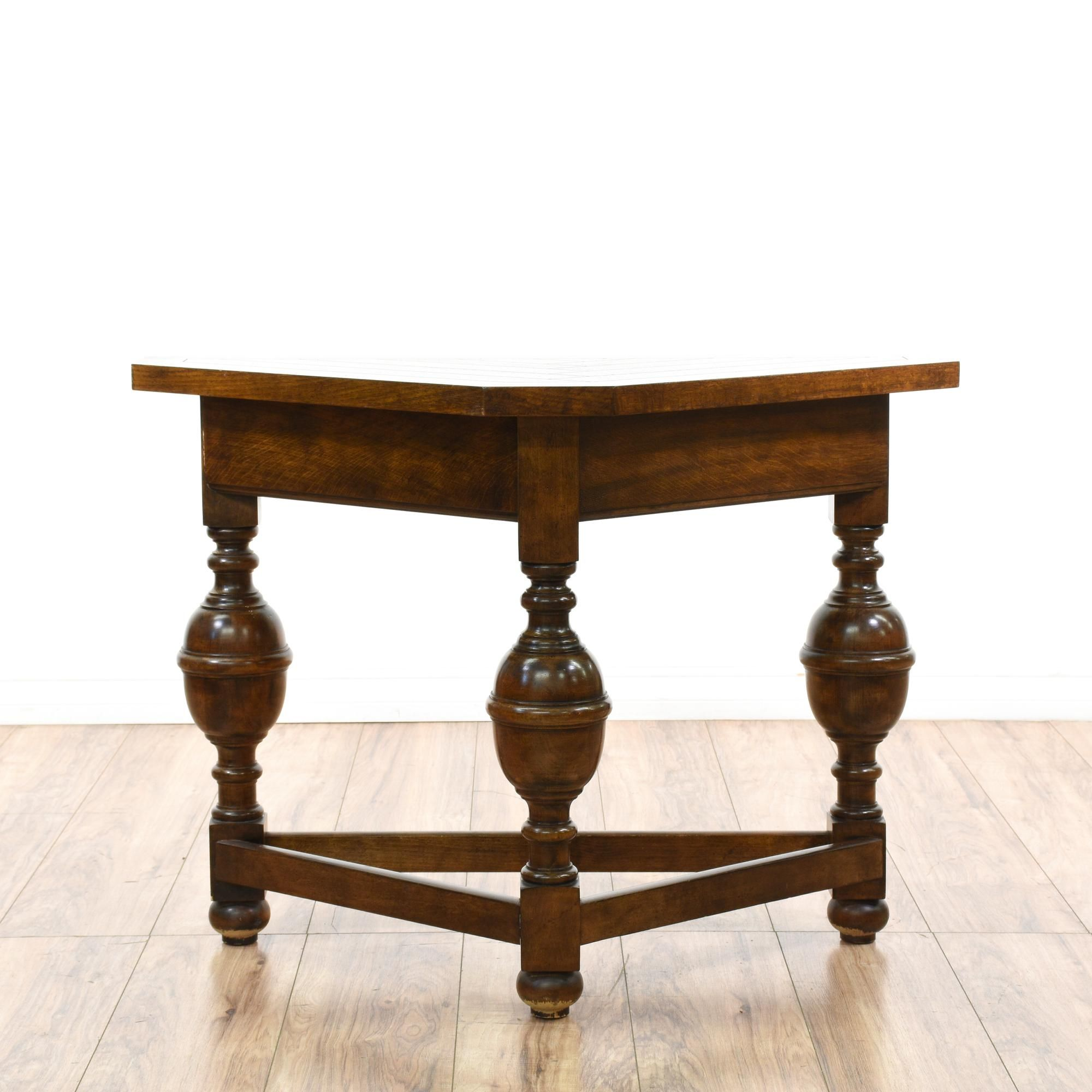 This corner console table is featured in a solid wood with a this corner console table is featured in a solid wood with a glossy dark cherry finish this side table has a triangle corner top with bulky turned spindle geotapseo Gallery