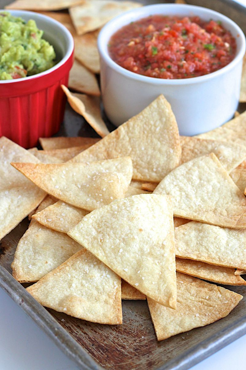 Easy baked tortilla chips that are healthier and great for dipping or making nachos.