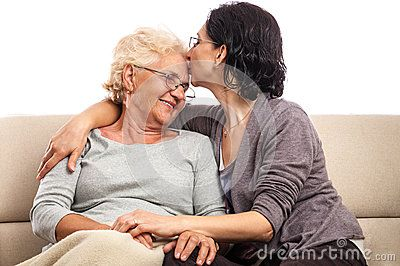 Loving Family Adult Daughter Giving Old Mom A Kiss Portrait Of