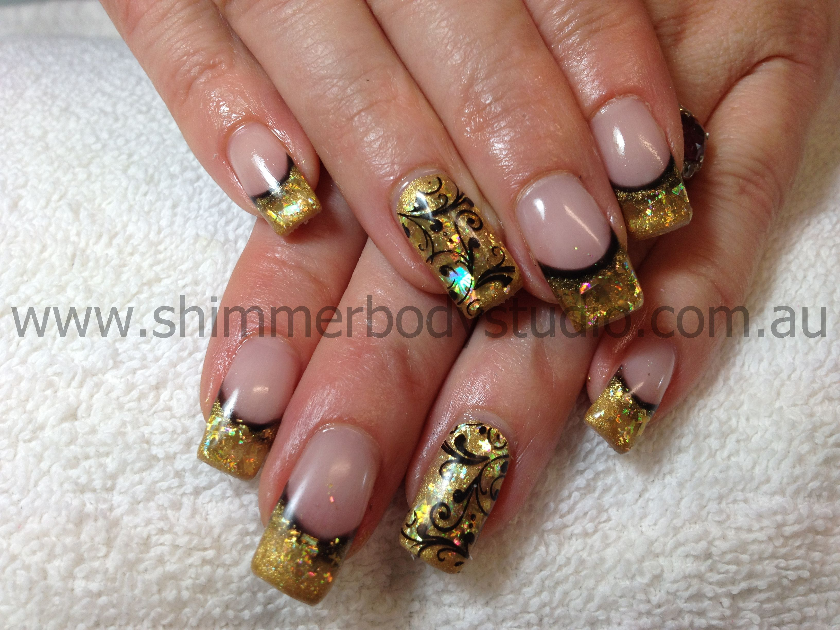 Gel nails, gold and black nails, glitter, konad stamping nail art ...
