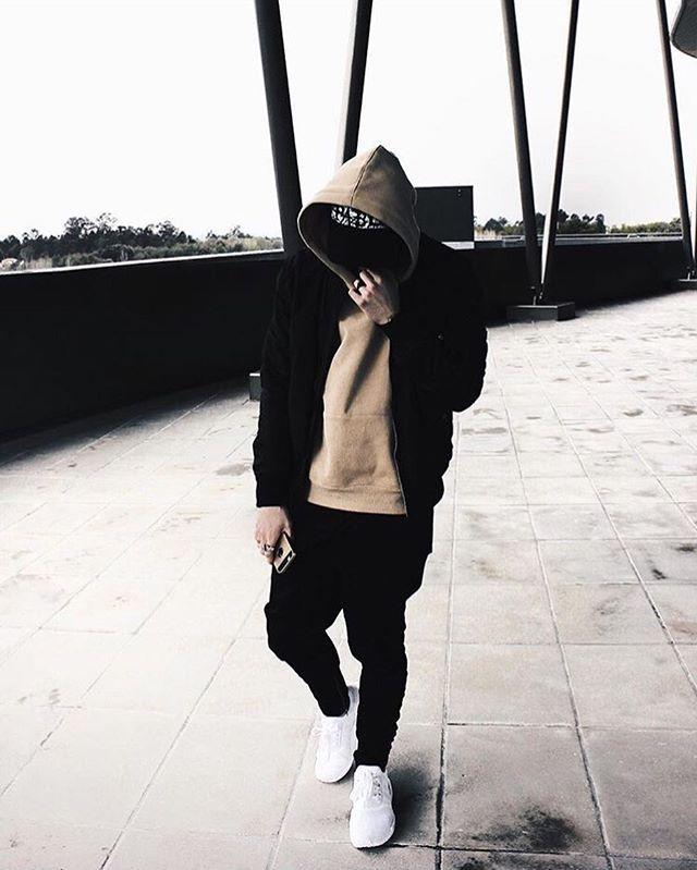Miguel in the oversized beige hoodie