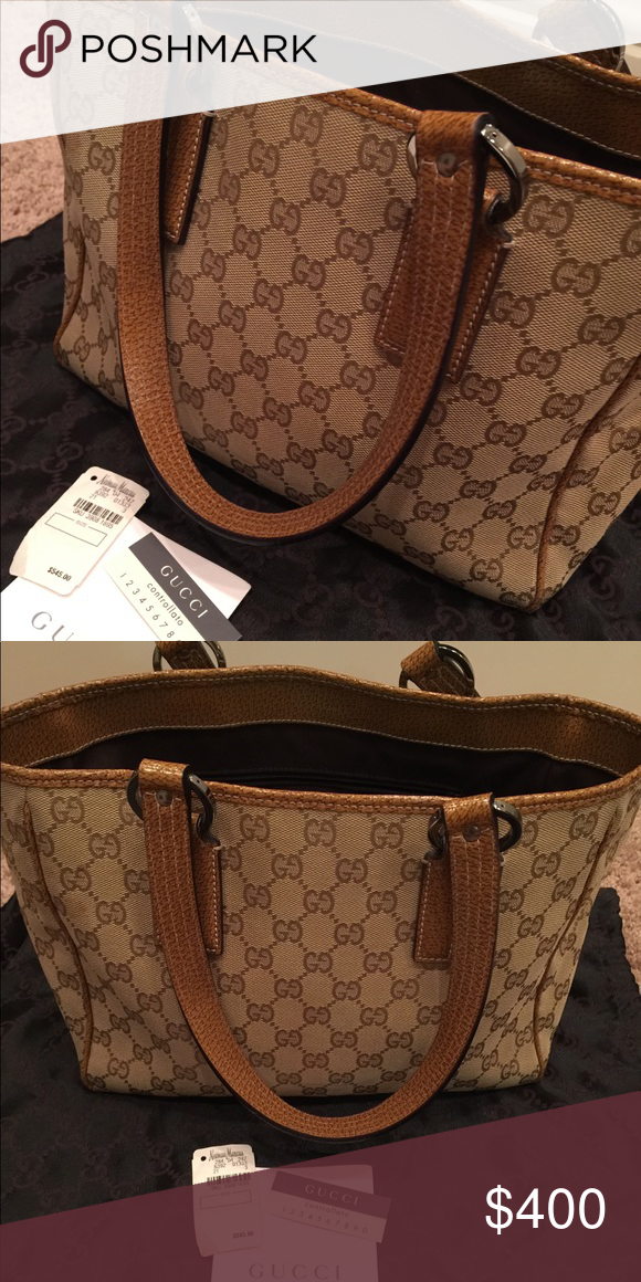 6e30b3935 Gucci Canvas Tote Bag Moderately used, still in great condition! %100  authentic, medium sized, comes with dust bag. Gucci Bags Totes