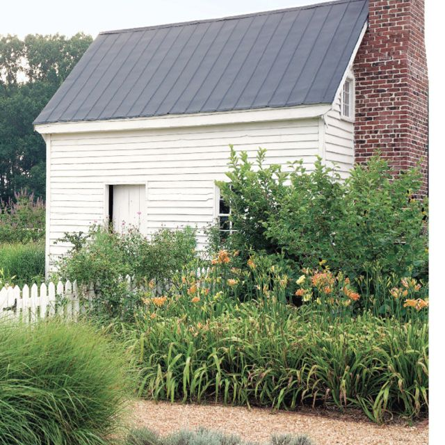 Brick Around Shed With Mulch And Flowers: Elemeno Farm Inspiration