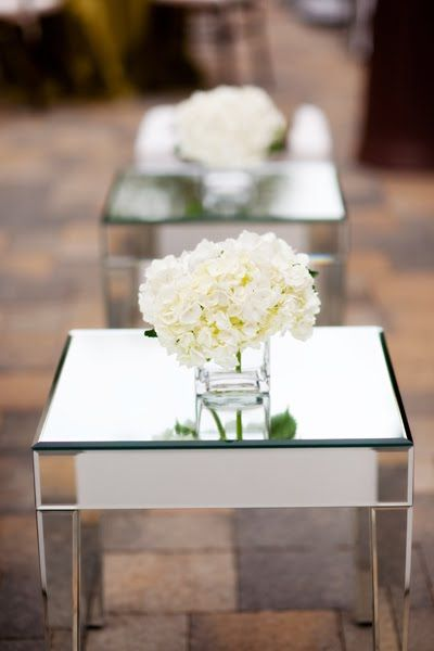 The cocktail tables will have small square vases with