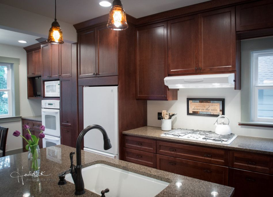 dark oak cabinets with white countertops and