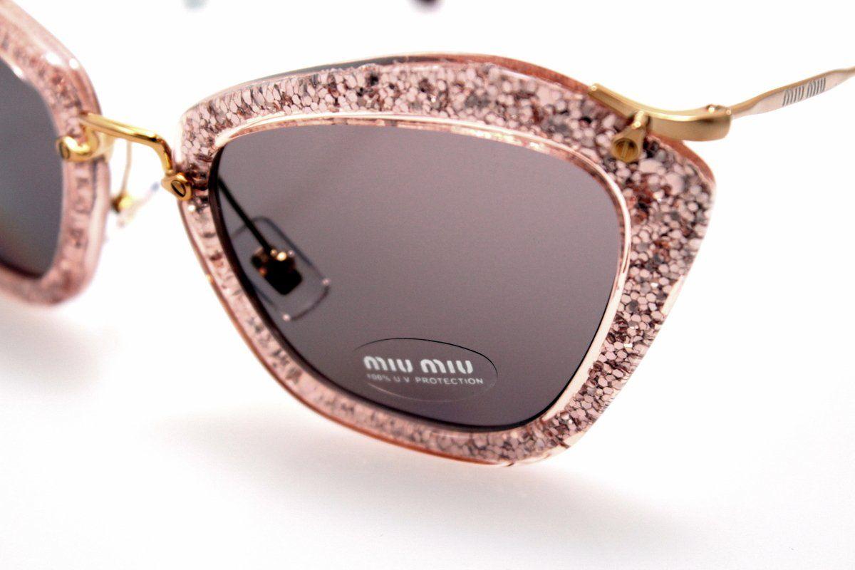 a57a1718618a Amazon.com  Miu Miu 10NS TKB6X1 Pink Silver Glitter 10NS Cats Eyes  Sunglasses Lens