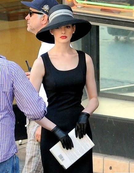 """A very classy Anne Hathaway playing Catwoman on the set of """"The Dark Knight Rises"""""""
