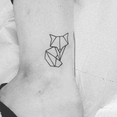 geometric fox tattoo on foot