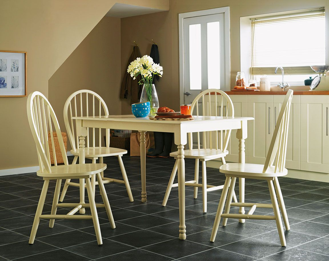 This beautifully crafted cream table and chairs set from