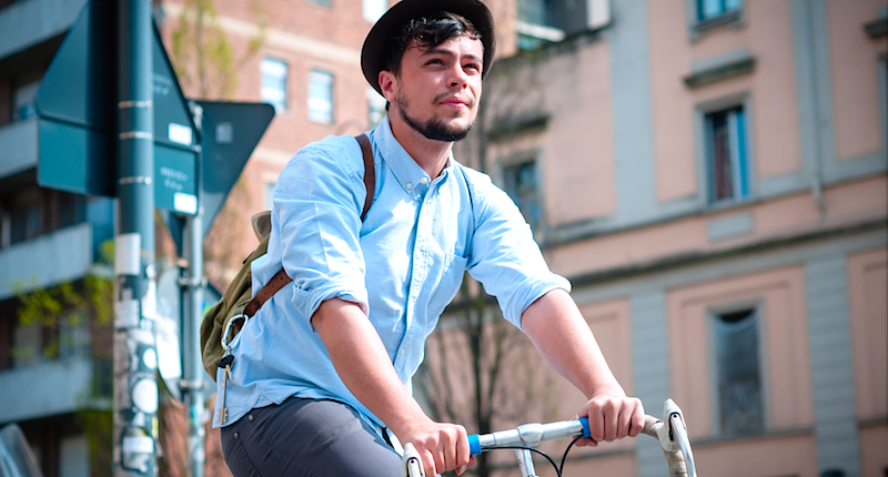 Hipster riding bicycle (Shutterstock)