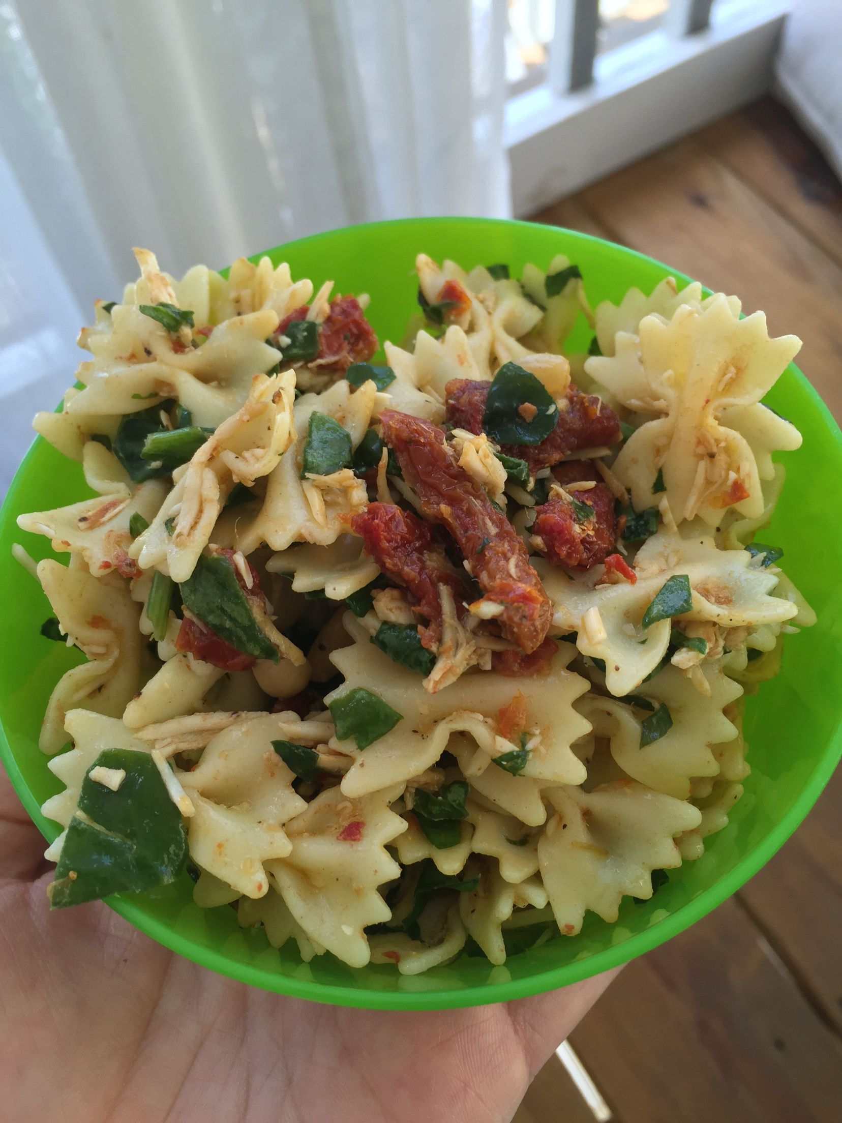 Jaclyn's Pasta Salad // Fresh basil, fresh spinach, Parmesan cheese, bow tie pasta, lemon, olive oil, and Italian seasoned sundried tomatoes packed in oil (glass jar), salt and pepper - all to taste