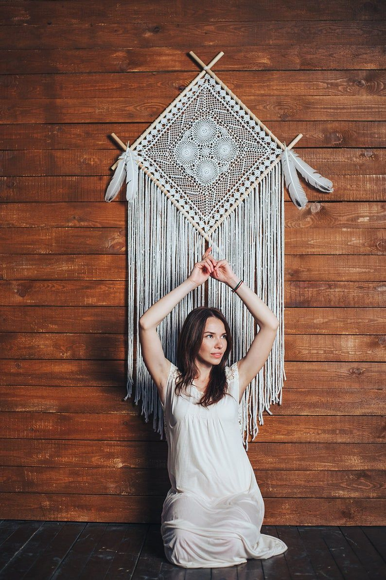 Would this unique boho dream catcher wall hanging melt your heart? Absolutely. This is a beautiful handcrafted wall art piece that will bring peace and serenity to your bedroom. Consider this white dream catcher, if are looking for a gift for a boho lover. Hygge wall art for a dream bohemian home. Pure beauty. #girlsroom #daughtergift #bohodreamcather #bohemiandecor #wallartgift