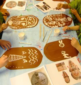 The children looked at the patterns and imagery adorning West African tribal masks, before creating their own striking examples. Each child was given a mask shape cut out from brown paper, which th…