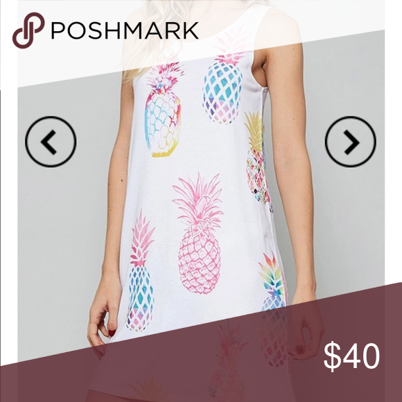 New. Pineapple dress I have one large left in this item Dresses Midi