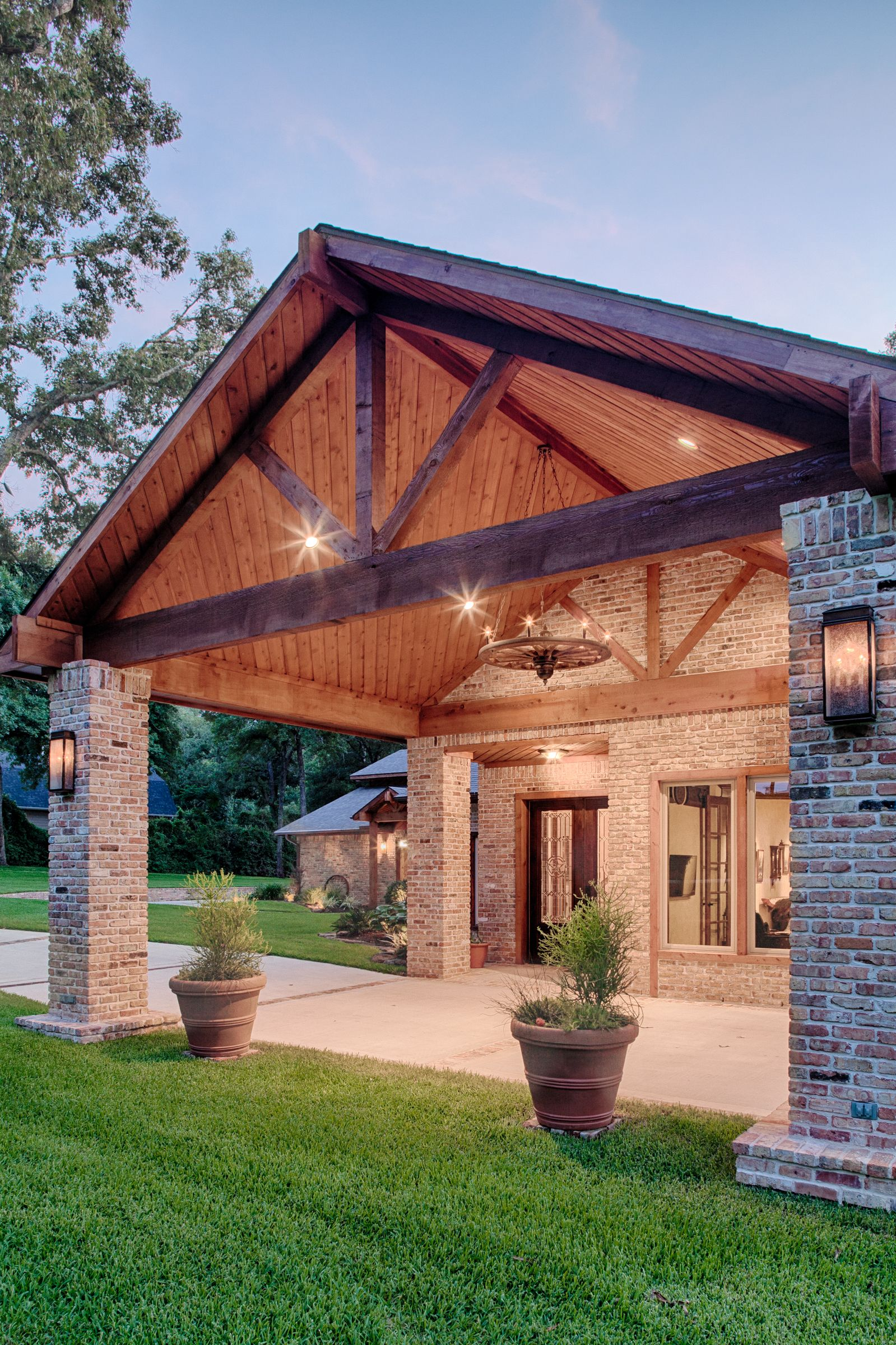 Covered Driveway House With Porch Lighting