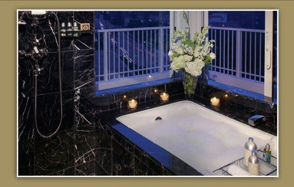 Sunken Tub Is Enclosed With Importe D Italian Black Marble You Have To Light Your Own Candles Whitney Houston Whitney Hilton Hotels Room