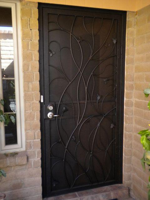 Security Screen Door By Torres Welding Uses Perforated Metal Instead Of Screen Security Screen Door Metal Screen Doors Screen Door