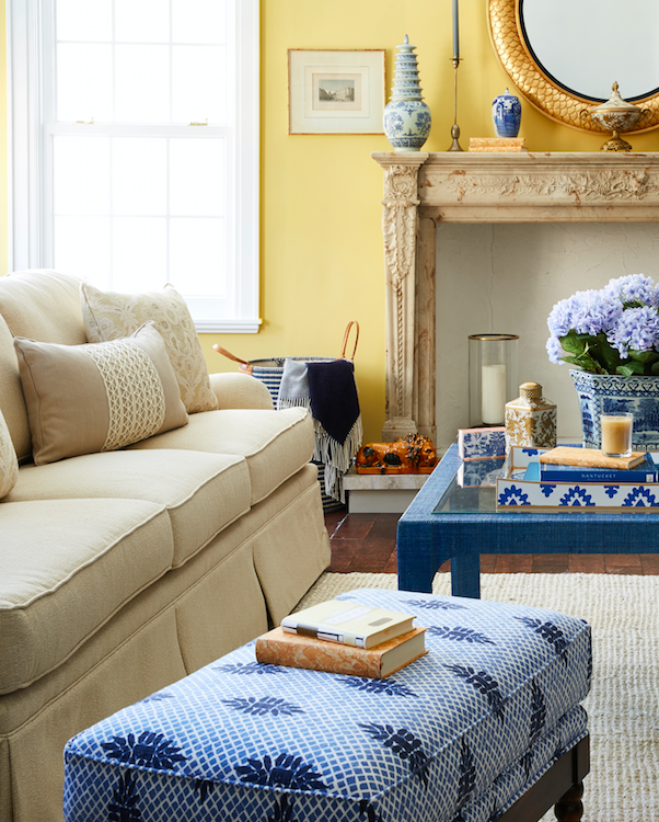classic blue white and beige living room design with a warm yellow