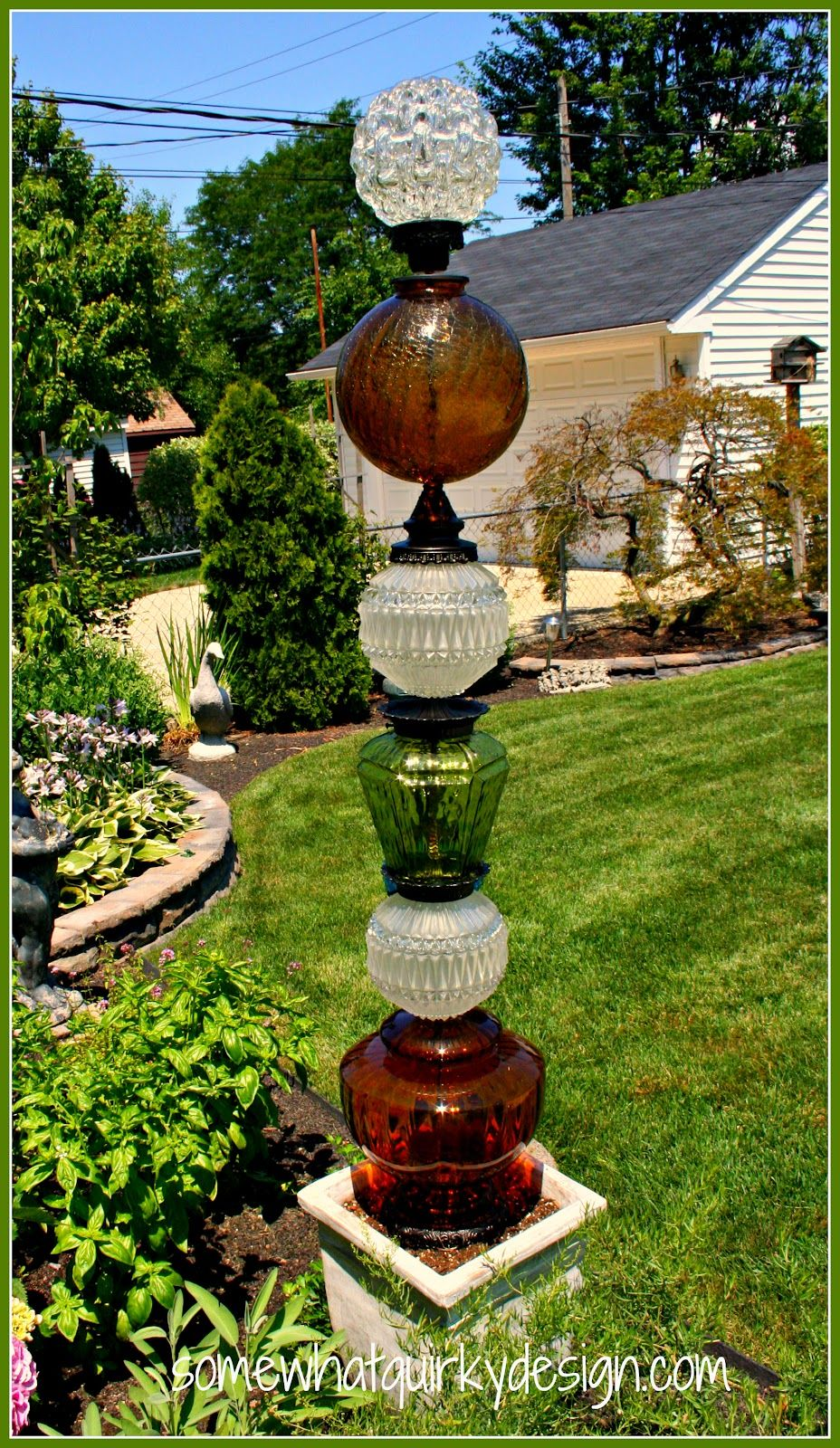 Glass yard art  Somewhat Quirky Building Glass Towers  tall glass totem poles