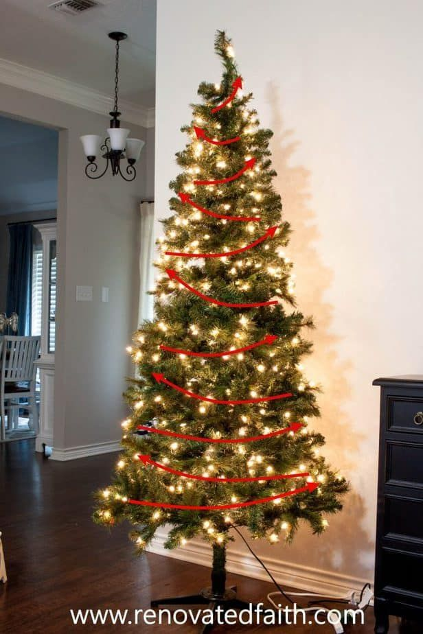 Decorate a Christmas Tree Step by Step (Ribbon on Tree-Ideas & Hacks) #ribbononchristmastreeideas How To Arrange Christmas Tree Lights – Step 2 made all the difference!  Ideas on how to decorate and add ribbon to a Christmas tree on a budget.  Decorate your tree like a pro in just a few easy steps.  Works with mesh, garland, tulle and ribbon, even burlap for a beautiful tree through the holidays!  #christmastree #christmasdecor #ribbononchristmastreeideas