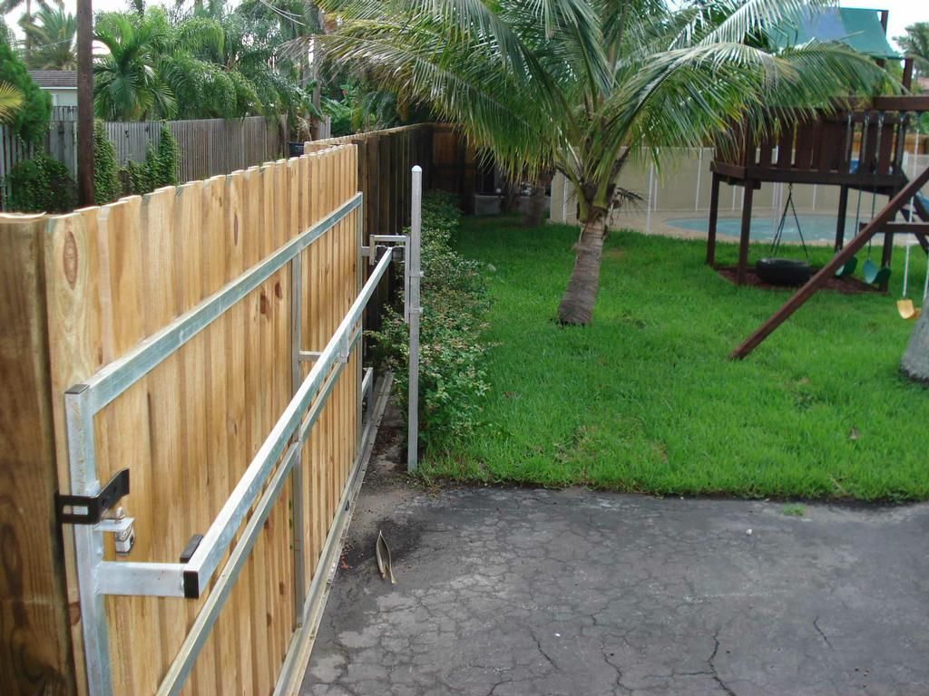 Wrought iron driveway gates and fence automatic gate for Building a sliding gate for a driveway