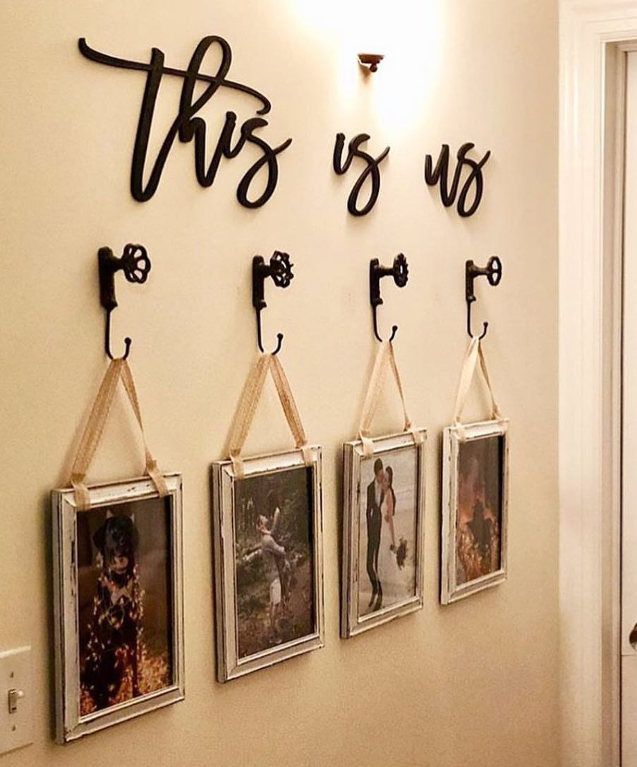 I Love This Wall Decor Idea This Is Us Hanging Picture Frames On Doorknob Hooks How Adorable Is This Thisisus Diy Pallet Wall Art Easy Home Decor Decor
