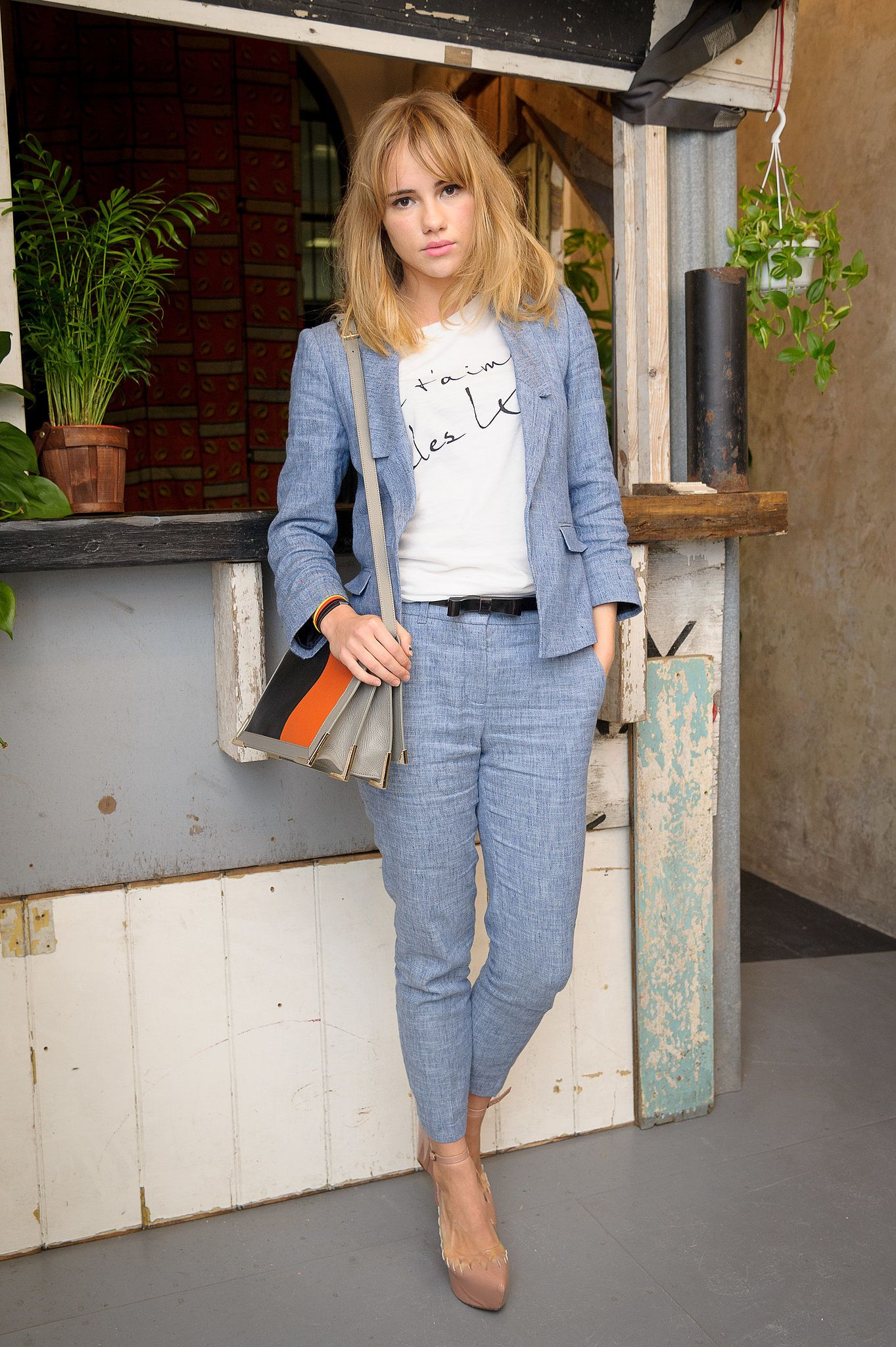 Mastering the art of the fashion-blogger pose, Suki showed off her love of sets back in May 2012 at a London party.