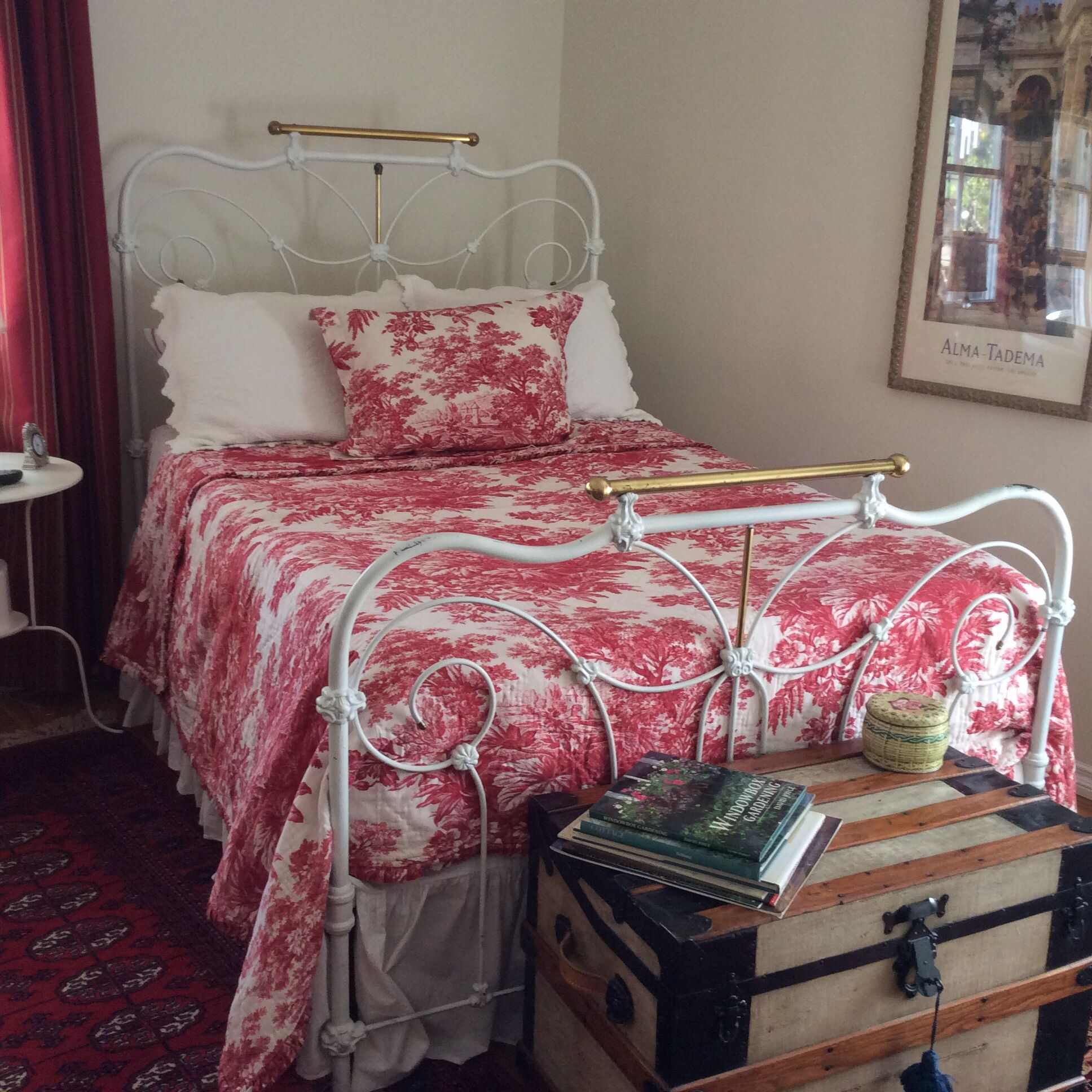 Vintage Iron Bed And Cranberry Toile In Bedroom