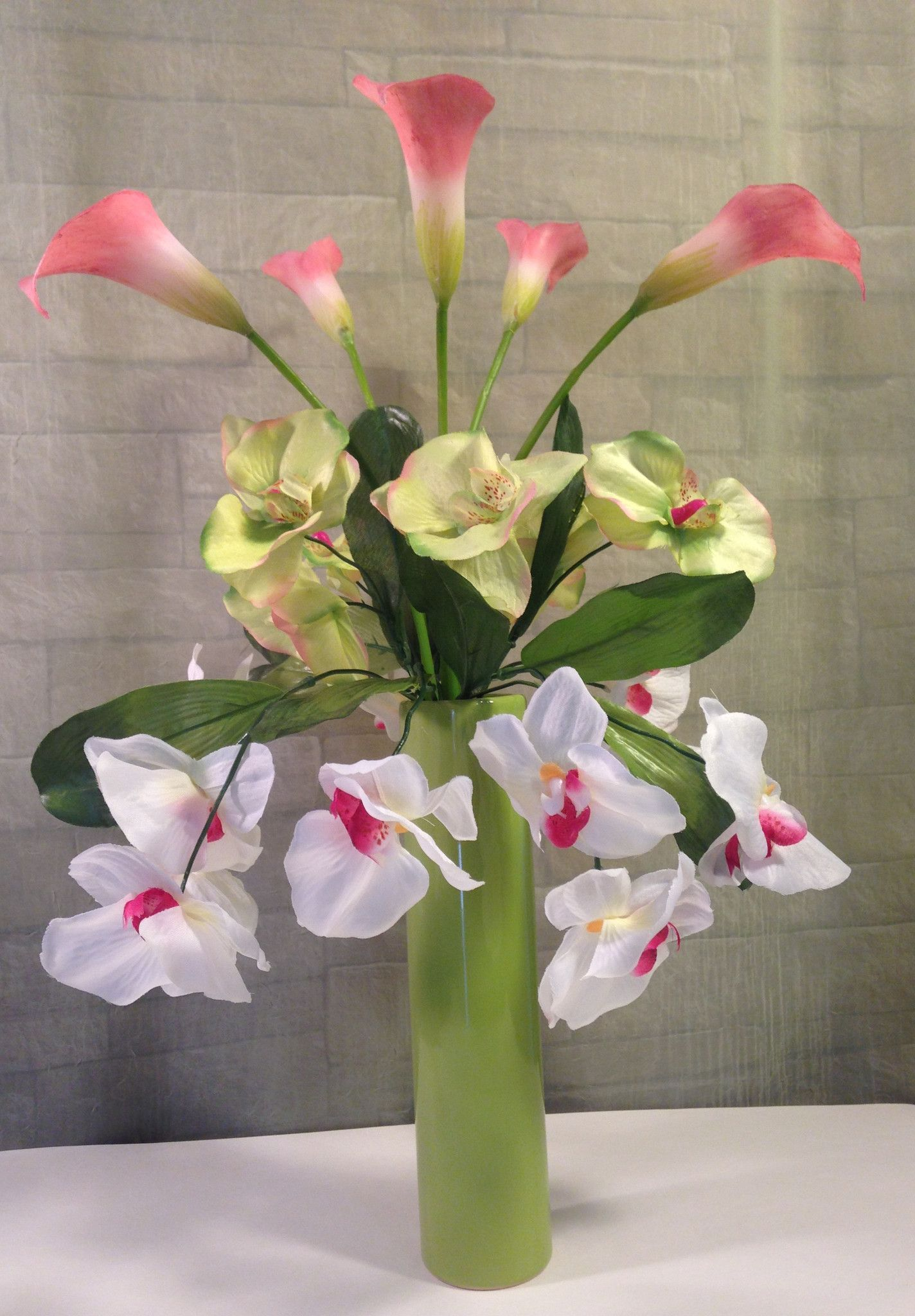 Phalaenopis orchid and calla lily arrangement calla lilies phalaenopis orchid and calla lily arrangement dhlflorist Images