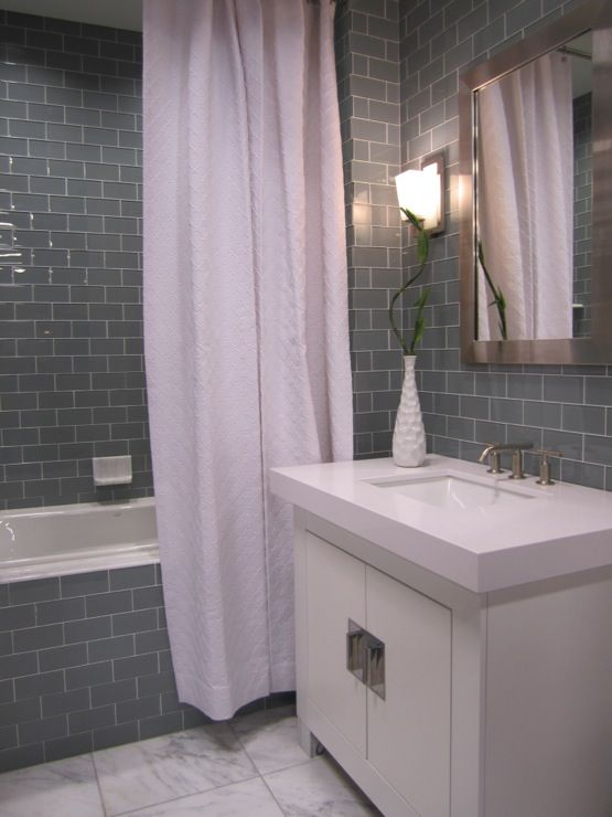 kirsty froelich glass tile bathroom with marble floor waterfall vanity - Bathroom Gray Subway Tile
