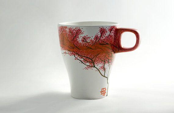 He encontrado este interesante anuncio de Etsy en https://www.etsy.com/es/listing/269349566/taza-pintada-a-mano-con-arbol-japones