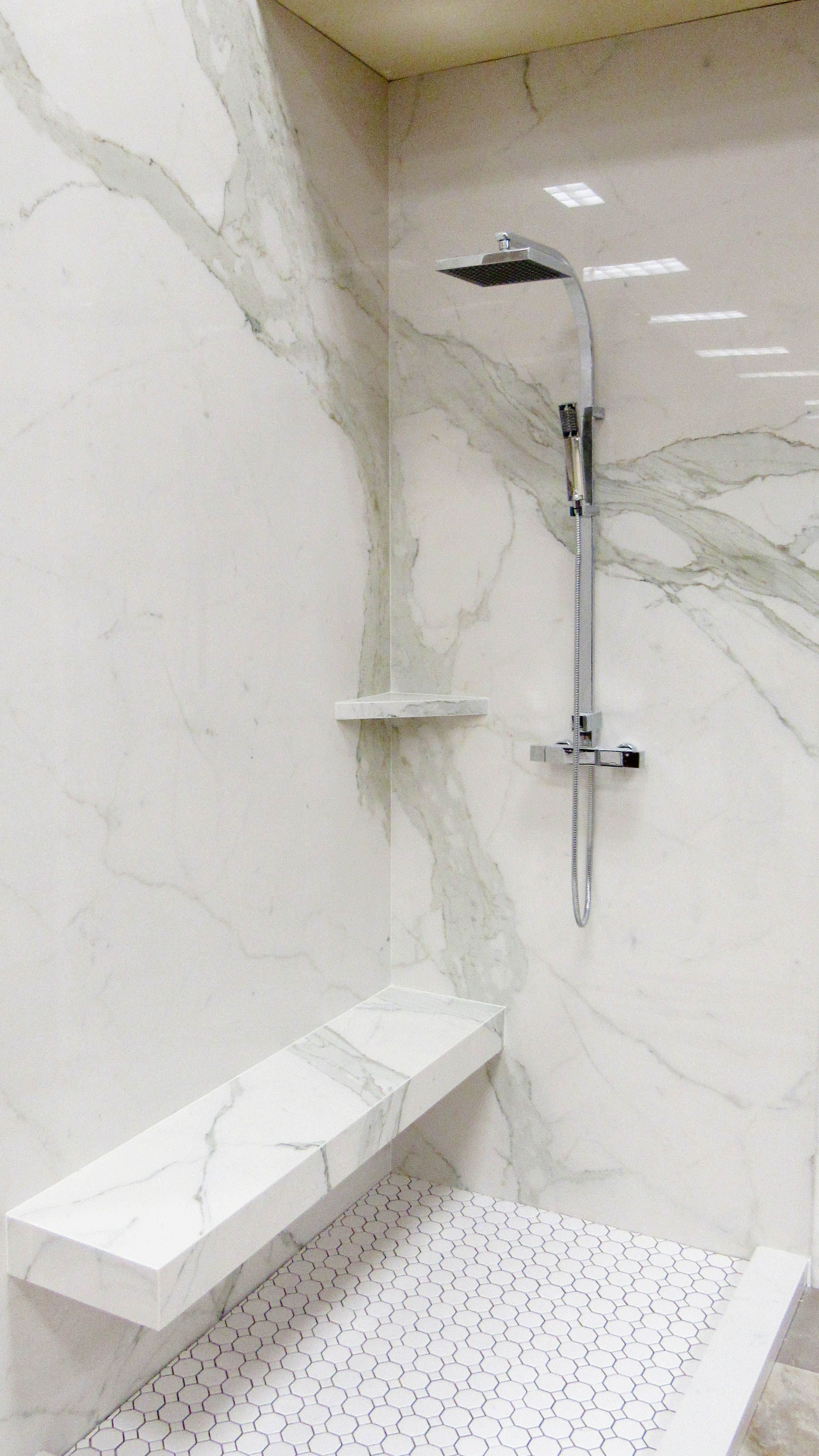 Grout Less Shower System Using Plane