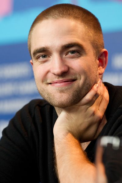 Robert Pattinson shows off his shaved head in Berlin.... WHY ROBERT WHY!!??!!?