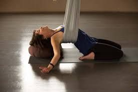 image result for restorative aerial yoga with images