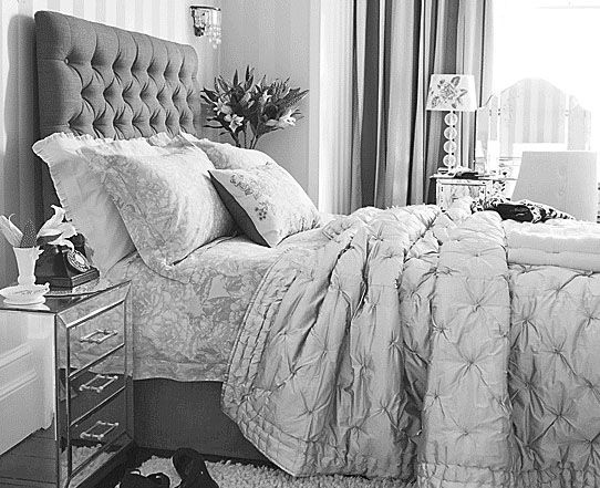 Tufted headboard   mirrored furniture reflect Hollywood Regency style. Dear Designer  Tufted headboard   mirrored furniture reflect