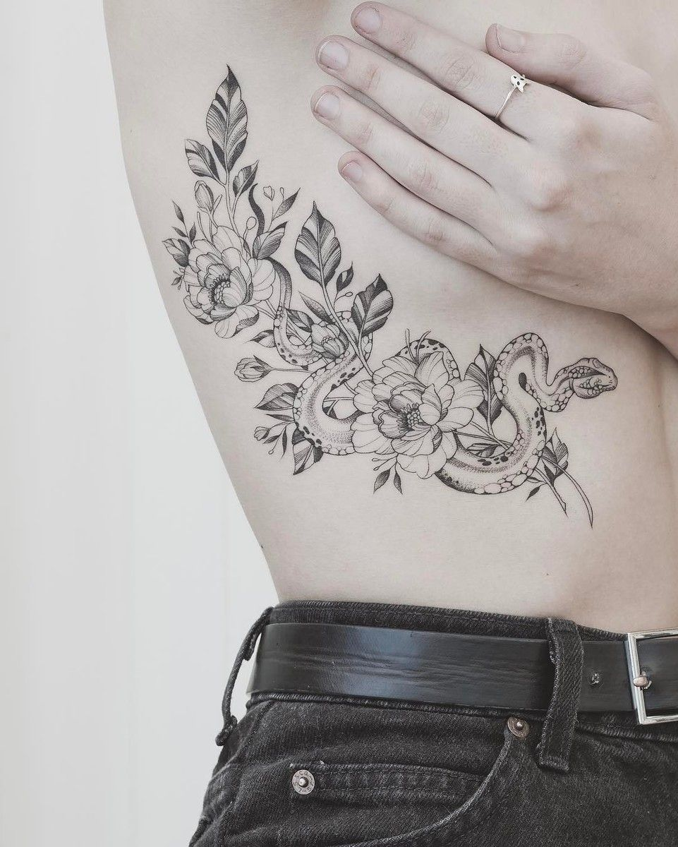 fineline snake and flowers tattoo on the ribs Snake