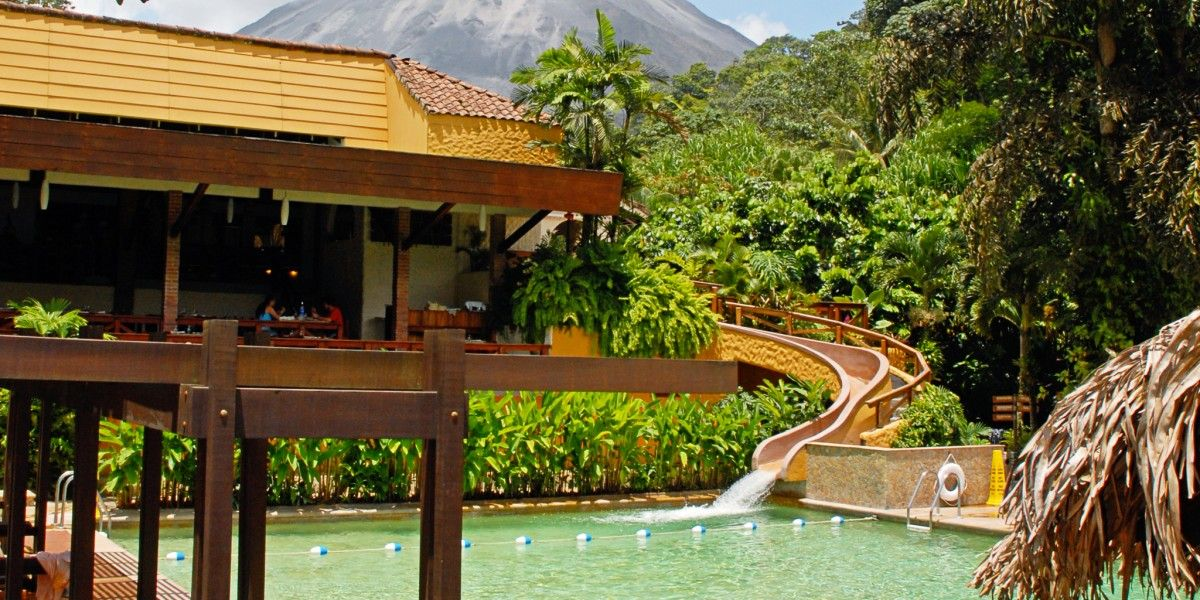 first travel pin- I loved Tabacon! It was wonderful. Went there in the off season and it wasn't too crowded. Very  nice hotel     Tabacon's pool, Jacuzzi and water slide have clear views of the Arenal Volcano. #Jetsetter