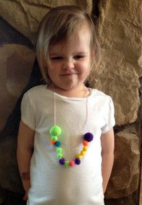 riley with her pompom necklace 1
