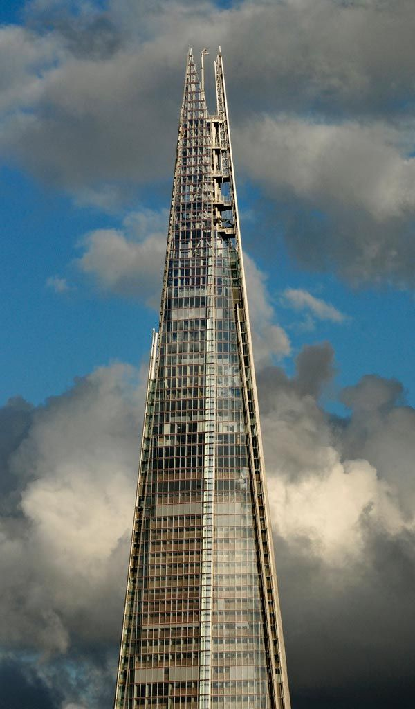 One London Bridge Tower (Shard of Glass), London, England by Darrell Godliman, interesting photo the buildings blue glass looks transparent gray here