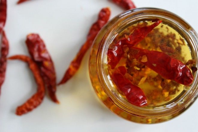 chilis in oil - Chili oil is essentially dried chilies, preserved in oil. It has become extremely popular as it provides a delightful kick to whatever dish you're using it in. Commonly used as a finishing oil for risottos, pastas and seafood, it's also a great oil for stir-fries and everyday sautés.